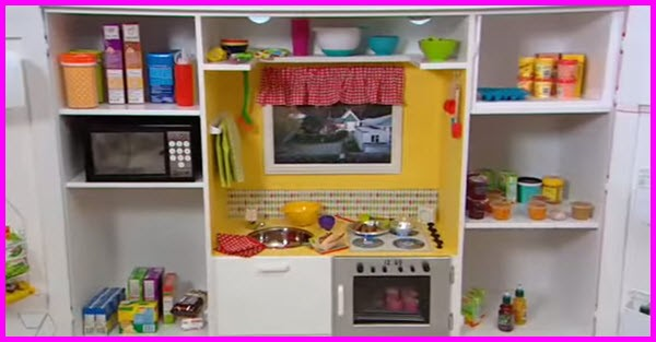 a play kitchen built out of an old tv cabinet gotta go do it yourself